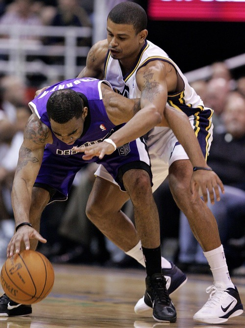 Djamila Grossman  |  The Salt Lake Tribune  The Utah Jazz' Earl Watson (11) tries to grab the ball from the Sacramento Kings' Marcus Thornton (23) during a game at Energy Solutions Arena in Salt Lake City, Utah, on Saturday, March 5, 2011. The Jazz won the game.