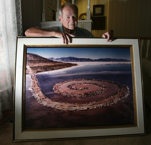 Steve Griffin     The Salt Lake Tribune    Bob Phillips holds a giant photograph, taken by photographer Gianfranco Gorgoni, of the Spiral Jetty.  Phillips was the contractor who built the Spiral Jetty for artist Robert Smithson.
