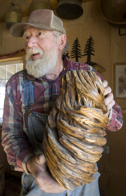 Al Hartmann  | The Salt Lake Tribune Vaughn Reid displays a piece of juniper tree which he has twisted with a lathe to form an artistic design. The 72-year-old retiree has made lamps, tables, bowls and coat racks out of downed timber that he has found in the hills around Emery County, displaying many at his