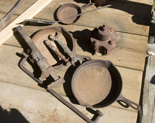 Al Hartmann  | The Salt Lake Tribune Over the years, Vaughn Reid has collected a treasure's trove of artifacts that reflect the history of white settlement in Emery County. Old tools and fry pans sit on the front step of a log cabin that Reid built between Ferron and Clawson, a