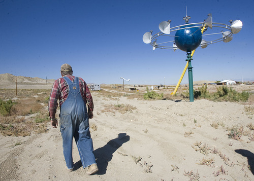 Al Hartmann  |  The Salt Lake Tribune Master machinist and welder Vaughn Reid walks to one of the UFO sculptures that he has erected on his property in Emery County between the towns of Ferron and Clawson. A sign near the alien landing site says