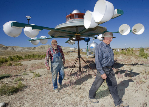 Al Hartmann  |  The Salt Lake Tribune Retired machinist and welder Vaughn Reid, left, and his friend Rich Fairbanks, a longtime Emery High School teacher, have worked together to create UFO sculptures whose buckets catch the county's prominent winds, making them spin. The UFOs are just an introduction to the