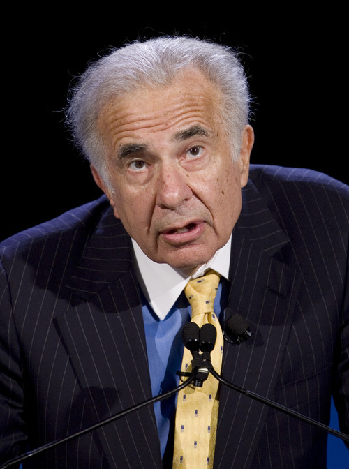 FILE - In this Oct. 11, 2007 file photo, activist investor Carl Icahn speaks at the World Business Forum in New York. Genzyme Corp. on Feb. 22, 2010.  Icahn is  giving back all of the money that outside investors hold in his hedge funds.  In a letter to limited partners, the billionaire investor said he did not want to be responsible to investors for