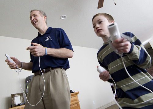 BYU exercise scientist Bruce Bailey plays the Wii with his son Dallin. Photo by Jaren Wilkey/Brigham Young University.