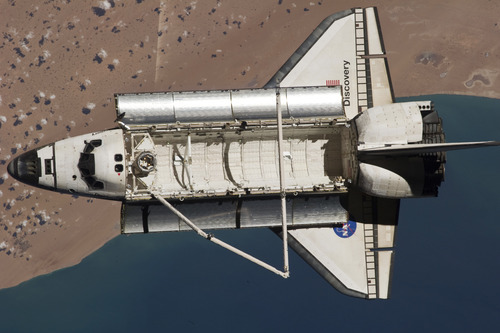 In this image provided by NASA the space shuttle Discovery is seen from the International Space Station as the two orbital spacecraft accomplish their relative separation on March 7, 2011 after an aggregate of 12 astronauts and cosmonauts worked together for over a week. The area below is the southwestern coast of Morocco in the northern Atlantic. During a post undocking fly-around, the crew members aboard the two spacecraft collected a series of photos of each other's vehicle.  Discovery is on the verge of ending its nearly 27-year flying career. Landing is set for Wednesday.  (AP Photo/NASA)