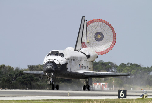 Space shuttle Discovery lands at the Kennedy Space Center in Cape Canaveral, Fla., Wednesday, March 9, 2011. Discovery ended its career as the world's most flown spaceship Wednesday, returning from orbit for the last time and taking off in a new direction as a museum piece. (AP Photo/Terry Renna)