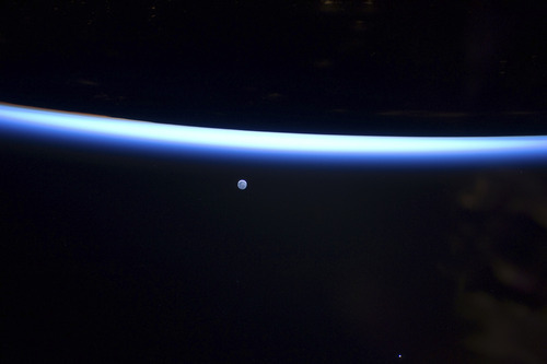 This image provided by NASA shows Earth's thin line of atmosphere and a gibbous moon are featured in this image photographed Sunday March 6, 2011 by an Expedition 26 crew member on the International Space Station. (AP Photo/NASA)