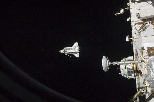 In this image provided by NASA the space shuttle Discovery is seen from the International Space Station as the two orbital spacecraft accomplish their relative separation on March 7, 2011 after an aggregate of 12 astronauts and cosmonauts worked together for over a week. During a post undocking fly-around, the crew members aboard the two spacecraft collected a series of photos of each other's vehicle. Discovery is on the verge of ending its nearly 27-year flying career. Landing is set for Wednesday.  (AP Photo/NASA)