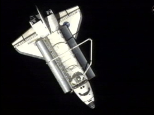In a frame grab made from NASA TV, space shuttle Discovery backs away from the the International Space Station after undocking for the last time Monday, March 7, 2011.   Discovery is due back on Earth on Wednesday. It's being retired after touchdown and sent to the Smithsonian Institution for display.  (AP Photo/NASA)