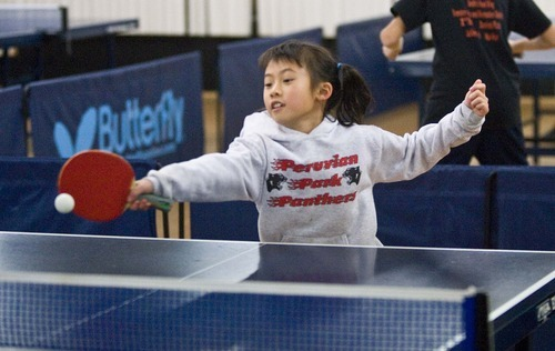... Tennis Training. Paul Fraughton   The Salt Lake Tribune Lynn Deng, 8,  Returns A Serve During