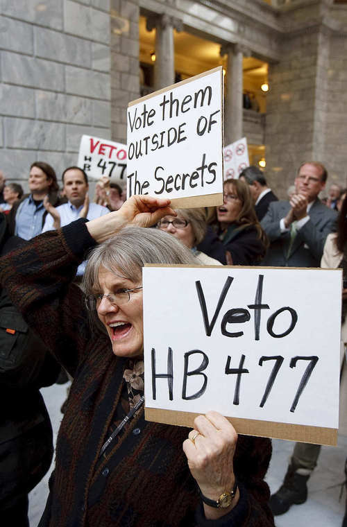 File photo  |  The Salt Lake Tribune Rep. Kraig Powell, R-Heber City, is shown, right, behind sign, at this March 8 Capitol rally against HB477. Powell is apologizing for his votes for HB477, changing Utah's open-records law. He now calls the legislation an