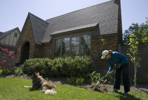 A Yalecrest resident does yard work in front of her Tudor-style home on Herbert Avenue in 2010.  On Wednesday, the Utah Senate gave final approval to a bill that would create a one-year moratorium on forming a historic district in the east Salt Lake City neighborhood.