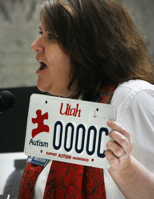 Scott Sommerdorf  |  The Salt Lake Tribune Laura Anderson of the Autism Council of Utah shows the specialized autism license plate that Rep. Becky Anderson, R-North Salt Lake, was instrumental in establishing. The plate was shown at an Autism Council of Utah event in the Capitol rotunda, Thursday, March 10, 2011.
