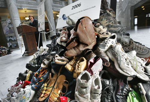 Scott Sommerdorf  |  The Salt Lake Tribune Dr. Judy Zimmerman, director of the Autism Registry, speaks at an Autism Council of Utah event in the Capitol rotunda, Thursday, March 10, 2011. Each of the 980 shoes in a pile in the foreground represents 10 children with autism in the state. The figure is based on a 2006 estimate that totaled 9,800 kids with autism in the state. Rep. Becky Edwards, R-North Salt Lake, was instrumental in getting the Autism Council a specialized Utah license plate this year.