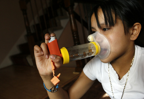 Francisco Kjolseth     The Salt Lake Tribune Karime Contreras, 10, of Salt Lake City, uses her controller inhaler on Tuesday, something she needs twice a day to help with her asthma. Neighborhoods like hers have higher rates of asthma hospitalization.