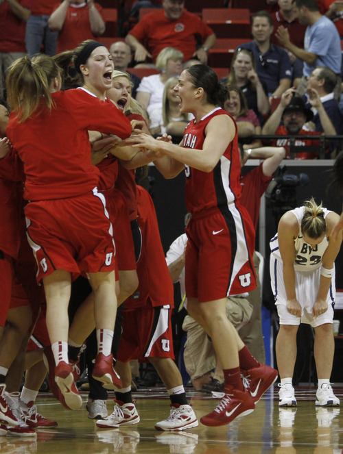 Rick Egan  | Salt Lake Tribune  The Lady Utes celebrate their last-second, one-point win over BYU on Friday at the Mountain West Conference Championships in Las Vegas. BYU forward, Dani Peterson on the right.