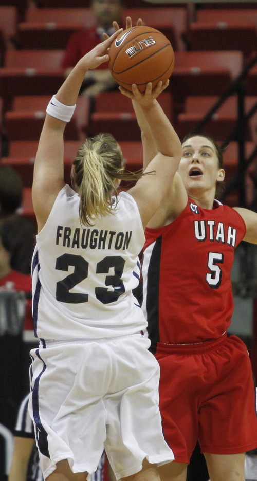 Rick Egan  | Salt Lake Tribune  BYU forward Coriann Fraughton (Wood) takes a shot, as Utah forward Michelle Harrison (5) defends,  in the Mountain West Conference Championships in Las Vegas, Friday, March 11, 2011.