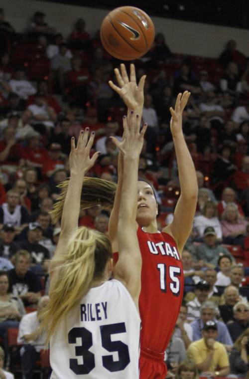 Rick Egan  | Salt Lake Tribune  BYU center Kristen Riley defends as Utah forward, Michelle Plouffe (15) takes a shot for the Cougars, in the Mountain West Conference Championships in Las Vegas, Friday, March 11, 2011.