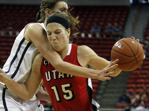 Rick Egan  | Salt Lake Tribune  BYU center Jennifer Hamson reaches for the ball, as Utah forward Michelle Plouffe (15) takes the ball inside, in the Mountain West Conference Championships in Las Vegas, Friday, March 11, 2011.