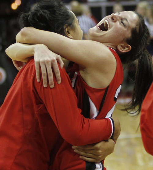 Rick Egan  | Salt Lake Tribune  Utah forward, Chelsea Bridgewater (21) (right) celebrates the Ute's one-point win over BYU, as Utah forward Michelle Plouffe (15) hit a shot at the buzzer to give the Utes a 50-49 win over the first-seed BYU Cougars, in the Mountain West Conference Championships in Las Vegas, Friday, March 11, 2011.