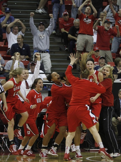 Rick Egan  | Salt Lake Tribune  The Lady Utes celebrate their one-point win over BYU after Utah forward Michelle Plouffe (15) hit a shot at the buzzer to give the Utes a 50-49 win over the first-seed BYU Cougars, in the Mountain West Conference Championships in Las Vegas, Friday, March 11, 2011.