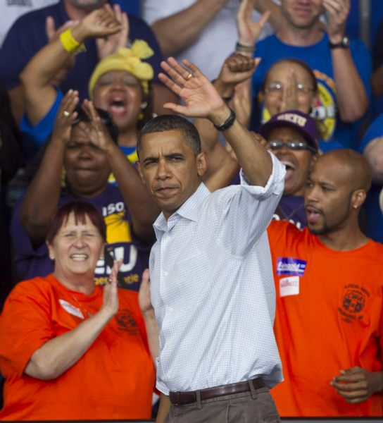 AP file photo President Barack Obama waves after speaking at the annual Milwaukee Area Labor Council Laborfest in Milwaukee, Wis., Sept. 6, 2010.  The Obama administration is treading carefully on the contentious political issue that has led to a national debate over the power that public sector unions wield in negotiating wages and benefits. And White House officials have stayed away from any trips to Madison, the state capital, or other states in the throes of union battles, despite urging by union leaders.