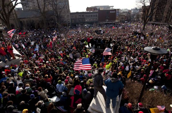 Morry Gash  |  The Associated Press Thousands of pro-labor protesters ralliy at the Wisconsin Capitol Saturday in Madison.