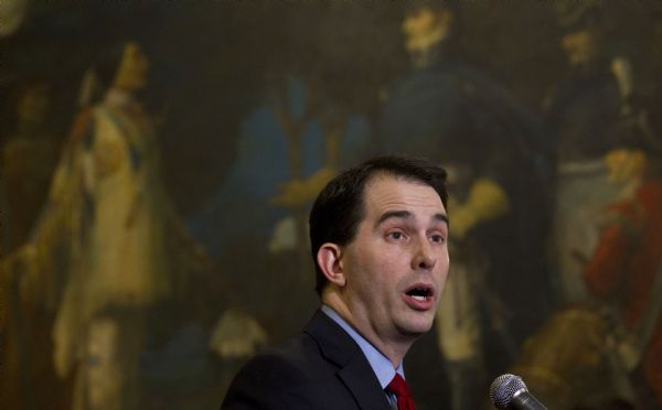 Morry Gash  |  The Associated Press Wisconsin Gov. Scott Walker speaks about the budget bill at a signing ceremony Friday in Madison.