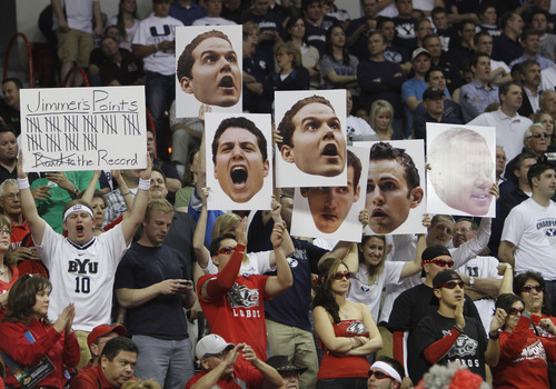 Rick Egan  | Salt Lake Tribune  New Mexico fans turns away as BYU fans  celebrate after Jimmer scores more than 50th points, and the Cougars extend their lead over the Lobos,  in the Mountain West Conference Championships, BYU vs. New Mexico,  in Las Vegas, Friday, March 11, 2011.  Fredette had 52 points for the Cougars in their 87-76 win over the Lobos.