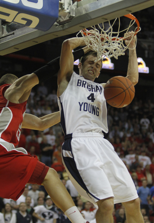 Rick Egan  | Salt Lake Tribune  BYU guard Jackson Emery (4) dunks the ball for the Cougars, in the Mountain West Conference Championships, BYU vs. New Mexico, in Las Vegas, Friday, March 11, 2011.