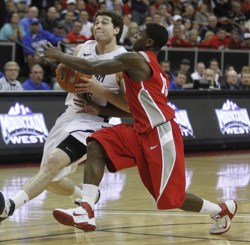Rick Egan  | Salt Lake Tribune  BYU guard Jimmer Fredette (32) drives up the middle, as New Mexico guard Jamal Fenton (13) defends for the Lobos, in the Mountain West Conference Championships, BYU vs. New Mexico, in Las Vegas, Friday, March 11, 2011.