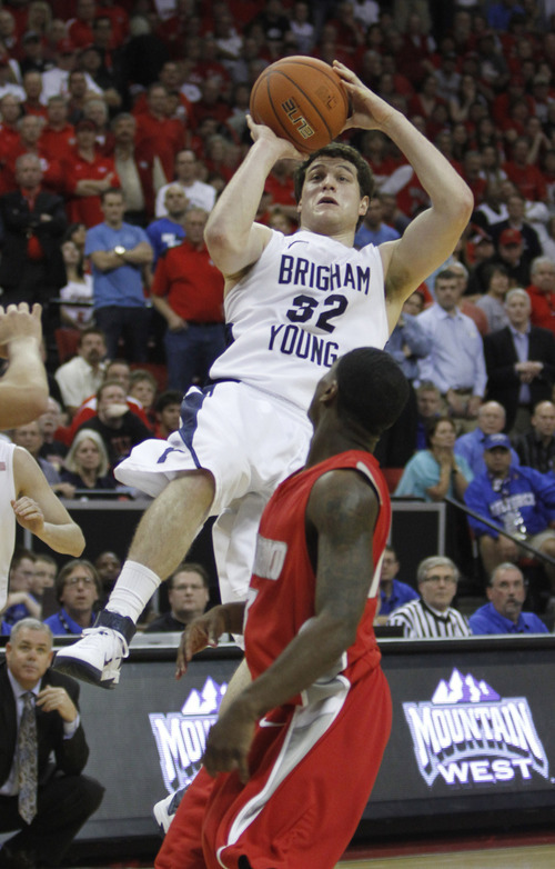 Rick Egan  | Salt Lake Tribune  BYU guard Jimmer Fredette (32) shoots  as New Mexico guard Jamal Fenton (13) defends for the Lobos, in the Mountain West Conference Championships, BYU vs. New Mexico, in Las Vegas, Friday, March 11, 2011.  Fredette had 52 points in the Cougar victory.