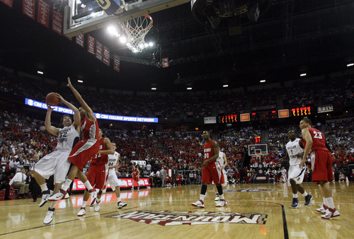 Rick Egan  | Salt Lake Tribune  BYU guard Jimmer Fredette (32) shoots for the Cougars, as New Mexico guard Kendall Williams (10) defends, in the Mountain West Conference Championships, BYU vs. New Mexico,  in Las Vegas, Friday, March 11, 2011.  Fredette had 52 points for the Cougars in their 87-76 win over the Lobos.