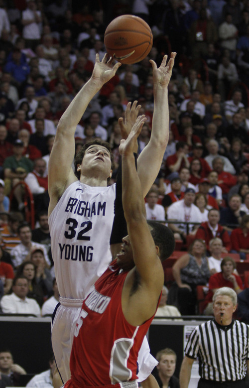 Rick Egan  | Salt Lake Tribune  BYU guard Jimmer Fredette (32) shoots for the Cougars, as New Mexico guard Dairese Gary (5) defends, in the Mountain West Conference Championships, BYU vs. New Mexico,  in Las Vegas, Friday, March 11, 2011.  Fredette had 52 points for the Cougars in their 87-76 win over the Lobos.
