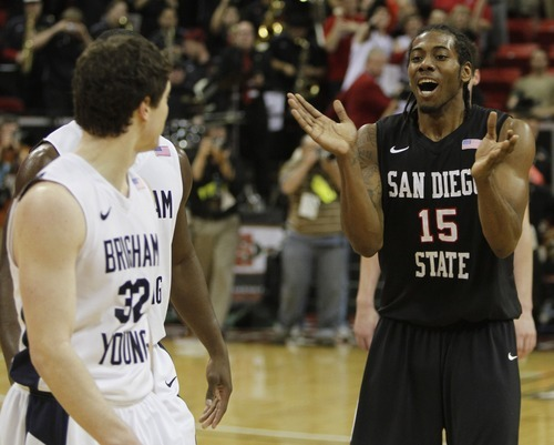 Rick Egan   |  The Salt Lake Tribune  As the Aztecs celebrate their big win, San Diego State forward Kawhi Leonard spends his time heckling BYU guard Jimmer Fredette (32) as the Cougars fell to the Aztecs 72-54 in the Mountain West Championship game, BYU vs. San Diego State, in Las Vegas, Saturday, March 12, 2011