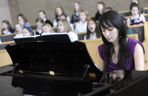 Sarah A. Miller  |  The Salt Lake Tribune  Vanessa Wall, a Bingham High senior, plays piano after school for the St. John the Baptist Catholic Church children's choir in Draper. Wall, like many teenagers, is involved in many activities and often stays up late to study. She wishes school started later so she could have more time to sleep. 3/10/11
