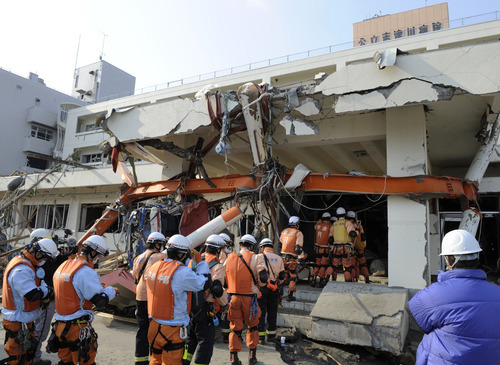 Firefighters head in the damaged Sizugawa Public Hospital to search for survivors in Minamisanriku in Miyagi  Prefecture (state), two days after the area was hit by the catastrophic earthquake and tsunami. (AP Photo/Kyodo News)