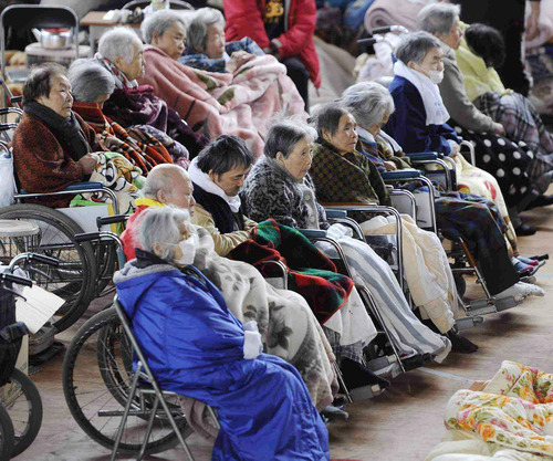 Elderly persons in wheelchairs take a rest at a shelter in Kesennuma, Miyagi Prefecture, northern Japan, Tuesday March 15, 2011, after Friday's earthquake and tsunami, (AP Photo/Kyodo News)