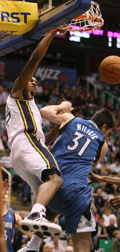 Steve Griffin  |  The Salt Lake Tribune    Utah Jazz forward Derrick Favors throws down a monster dunk over Minnesota's Darko Milicic during a game against the Timberwolves at EnergySolutions Arena  in Salt Lake City on Wednesday, March 16, 2011.