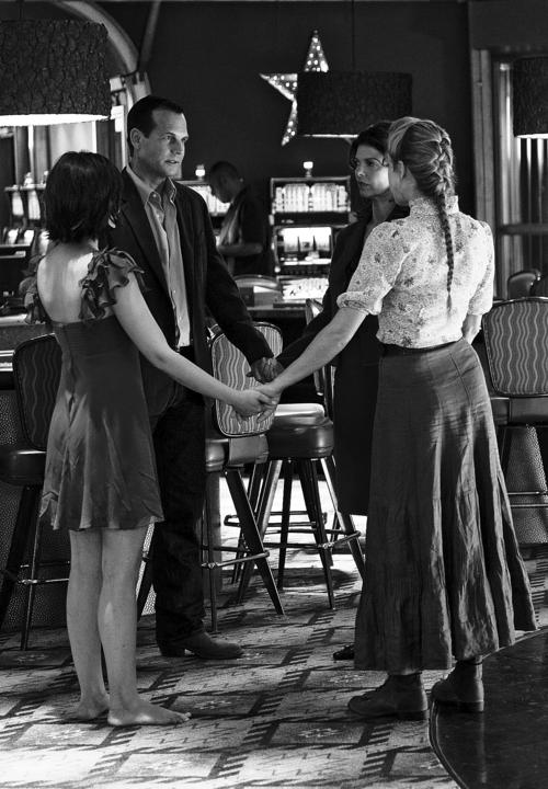 The Henrickson family prays in a scene from HBO's