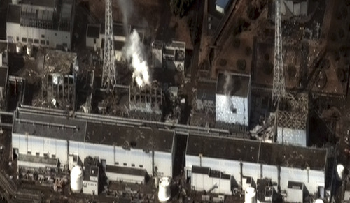 This satellite photo taken Wednesday March 16, 2011 and provided by DigitalGlobe shows the damage after an earthquake and tsunami at the Fukushima Dai-ichi nuclear power plant complex. The satellite image confirms damage to the Units 1, 3, and 4 reactor buildings.  Steam can be seen venting from the unit 2 reactor building, as well as from the Unit 3 reactor building. Additional damage can be seen to several other buildings approximately 350 meters north of the Unit 2 reactor building. (AP Photo/DigitalGlobe)
