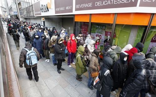 People queue outside a supermarket in downtown Sendai, Japan, Thursday, March 17, 2011. (AP Photo/Mark Baker)