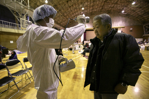 Wally Santana     The Associated Press A man is screened for radiation exposure at a shelter Wednesday after being evacuated from areas around the Fukushima nuclear facilities damaged by last week's major earthquake and following tsunami in Fukushima city, Fukushima prefecture, Japan.