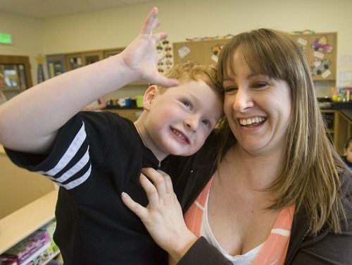 Paul Fraughton  |  The Salt Lake Tribune Amanda Goss  spends some time with her son Ian at South City Child Care on Monday March 7, 2011.