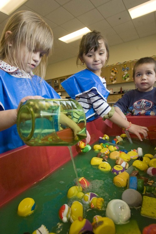 Paul Fraughton  |  The Salt Lake Tribune  Leayla Bartlett (4), Serenity Godoy (4) and Uati Johnson play in the water tub at South City Child Care  on Monday, March 7, 2011.