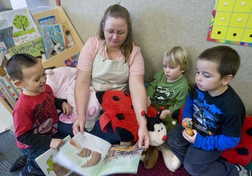 Paul Fraughton  |  The Salt Lake Tribune Wendy Blanchard, a child care worker at South City Child Care, reads a story to Makya Glover, 4, Simon Allred, 3, and Sam Johnson, 4, on Monday, March 7, 2011.