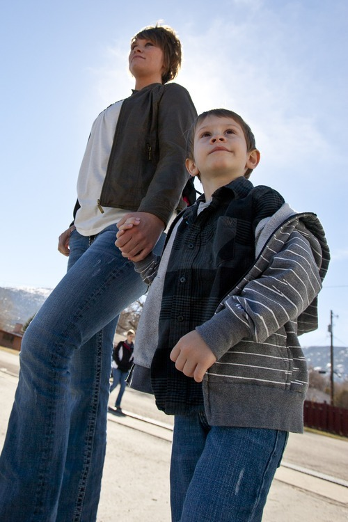 Kina Wilde  |  Special to The Salt Lake Tribune  Brandee Reese and her son Karson, 4, walk to their car from South Preschool in Cedar City on Tuesday, March 15, 2011.