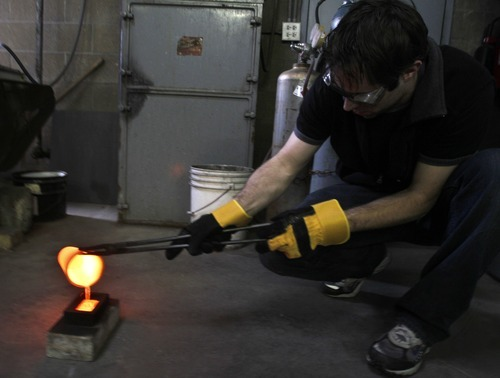 Rick Egan   |  The Salt Lake Tribune Christ Wright, pours silver into ingots at Cascade Refining in West Valley City Monday, March 14, 2011