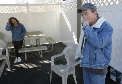 Rick Egan   |  The Salt Lake Tribune Sheila Dalton and Fred Whitting smoke in the smoking area at the Kelly Benson Apartments in West Valley City. The Salt Lake County Housing Authority apartments opened as smoke-free in 2010, but covered areas are provided for residents to smoke outside.