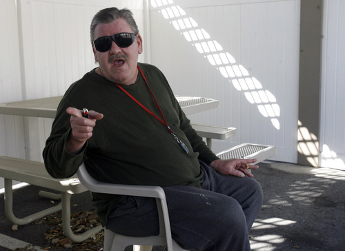Rick Egan   |  The Salt Lake Tribune Lloyd Best smokes in the smoking area at the Kelly Benson Apartments in West Valley City. Some public housing authorities in Utah are banning smoking in subsidized housing projects.